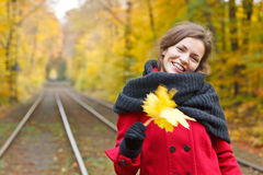 Smiling woman in autumn park. Young smiling woman in autumn park Stock Image