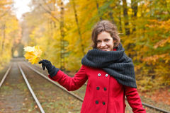 Smiling woman in autumn park. Young smiling woman in autumn park Royalty Free Stock Photos