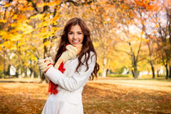Smiling  woman in autumn park Royalty Free Stock Images