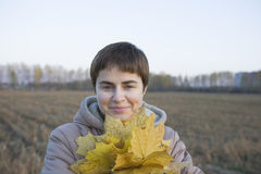 Smiling Woman With Autumnal Leaves In Field Stock Photos