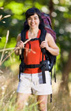Smiling woman with backpack Royalty Free Stock Photography