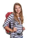 Smiling woman with a backpack Stock Images