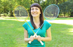 Smiling woman with badminton racket in the summer park Royalty Free Stock Images