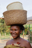 Smiling woman with bags on her head Royalty Free Stock Image
