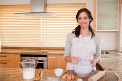 Smiling woman baking Stock Photo