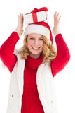 Smiling woman balancing christmas gift on her head Royalty Free Stock Photography