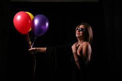 Smiling woman with ballons Royalty Free Stock Images