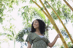 Smiling Woman In Bamboo Forest Royalty Free Stock Photo