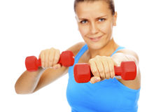 Smiling woman with barbells Royalty Free Stock Image