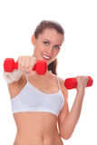 Smiling woman with barbells Stock Images