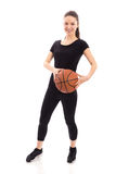 Smiling woman with basket ball Royalty Free Stock Photography