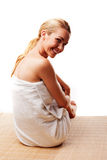 Smiling woman in a bath towel Royalty Free Stock Image