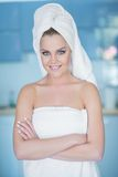 Smiling Woman in Bath Towel with Arms Crossed Stock Images