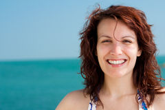 Smiling Woman on a Beach Royalty Free Stock Photos