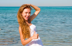 Smiling Woman at the beach Royalty Free Stock Image