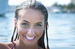 Smiling woman at the beach Royalty Free Stock Photography