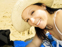 Smiling woman on the beach Stock Photos