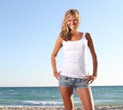 Smiling woman on beach background Royalty Free Stock Images