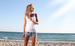 Smiling woman on beach background Stock Photography