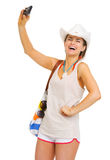 Smiling woman with beach bag taking self photo Royalty Free Stock Image