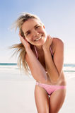 Smiling woman on beach Stock Images