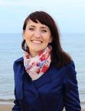 Smiling woman on the beach Stock Photos