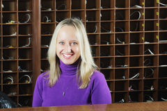 Smiling woman behind counter Royalty Free Stock Photo
