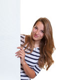 Smiling woman behind a signboard Royalty Free Stock Photos