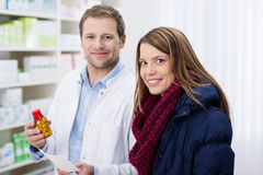 Smiling woman being helped in a pharmacy Stock Photography