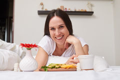 Smiling woman being pleased with breakfast Royalty Free Stock Images