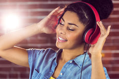 A smiling woman being transported by music Stock Images