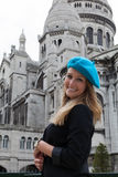 Smiling Woman in Beret Next to Sacre Coeur Royalty Free Stock Photography