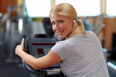 Smiling woman on bicycle Stock Photos