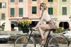 Smiling woman on bicycle outdoor sea Royalty Free Stock Images