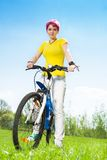 Smiling woman on bicycle Royalty Free Stock Photo