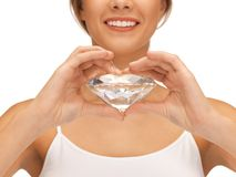 Smiling woman with big diamond Royalty Free Stock Photography