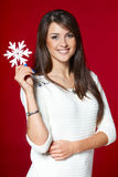 Smiling woman with big snowflake Royalty Free Stock Photo