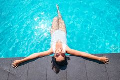 Smiling woman in big sunglasess relax in swiming pool on luxury. Resort Royalty Free Stock Photo