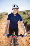 Smiling woman on bike Stock Image