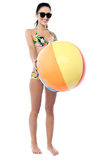 Smiling woman in bikini holding a beach ball Royalty Free Stock Image