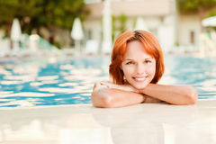 Smiling woman in bikini in pool Stock Image
