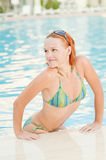 Smiling woman in bikini in pool Stock Photo
