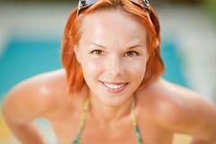 Smiling woman in bikini in pool Stock Photo