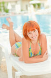 Smiling woman in bikini sunbathes Royalty Free Stock Photo