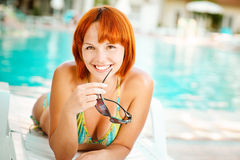 Smiling woman in bikini sunbathes Stock Photos