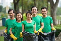 Smiling woman with bin bag Royalty Free Stock Photography