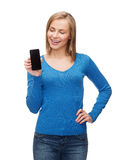 Smiling woman with black blank smartphone screen Royalty Free Stock Images