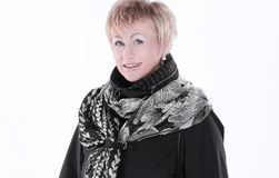 Smiling woman in a black coat and scarf.isolated on white. royalty free stock images
