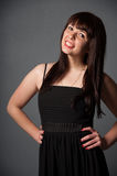 Smiling woman in black dress Stock Photos