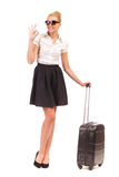 Smiling woman with Black Suitcase make OK sign. Stock Photos